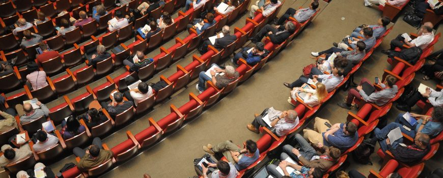 Aerial view of people sitting in conference